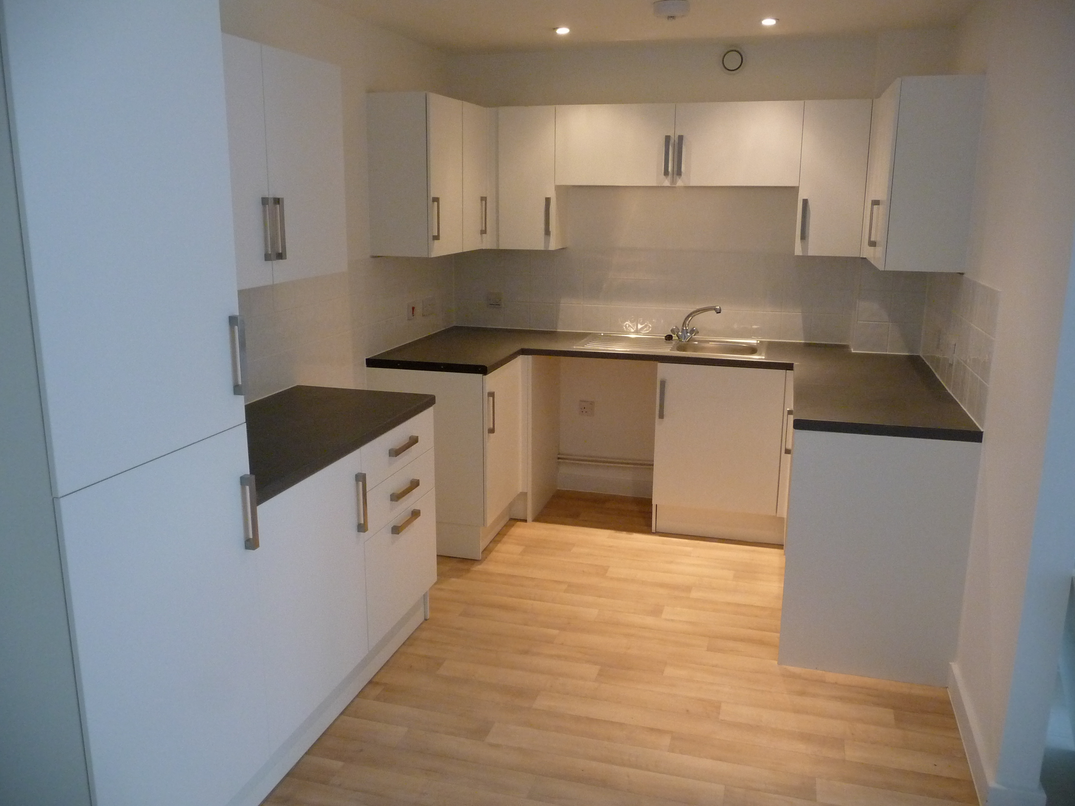 The Works Carried Out Included The Dry Fit Of All Base And Wall Units;  Inclusive Of Worktops And In Some Kitchens, Integrated Appliances And White  Goods.